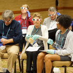 """Attendees participating in an exercise during the session """"Teaching Empathy to Millennials for These Tumultuous Times"""" at the 2017 AALS Conference on Clinical Education."""