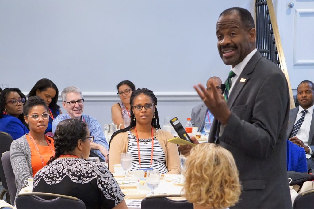 """George Washington Law School Dean Blake D. Morant discusses his """"Reflections on Teaching"""" during Saturday's workshop luncheon."""